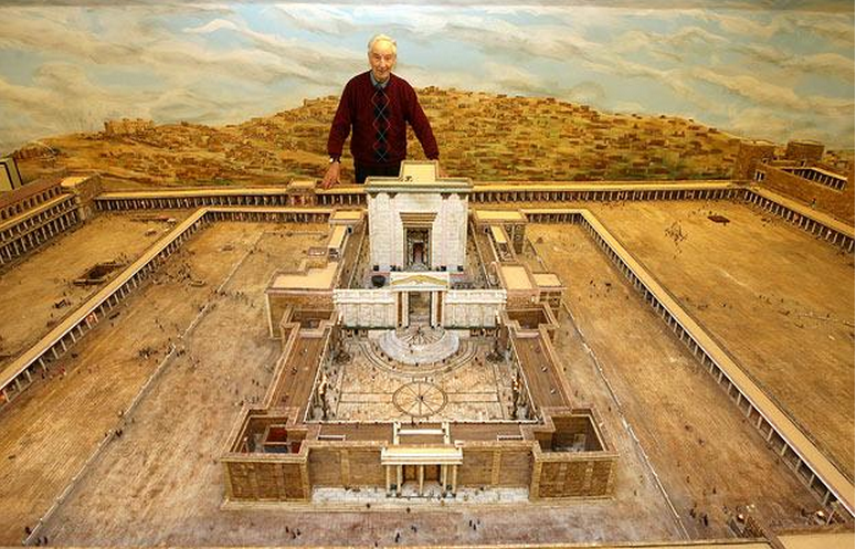 Alec Garrard standing behind his model of the temple. You can see the temple courtyards clearly.